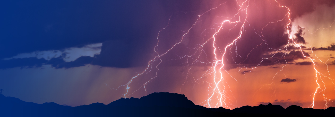 Lightning striking over a mountain